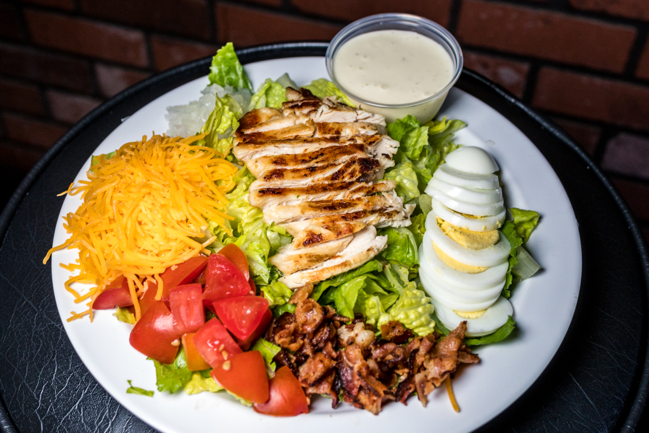 Chef Salad: spring mix, onion, tomato, cheese, egg, grilled chicken, and ranch / Image: Catherine Viox{ }// Published: 9.4.20