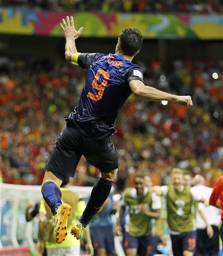 Netherlands' Robin van Persie celebrates after his scoring his side's fourth goal during the second half of the group B World Cup soccer match between Spain and the Netherlands at the Arena Ponte Nova in Salvador, Brazil, Friday, June 13, 2014.