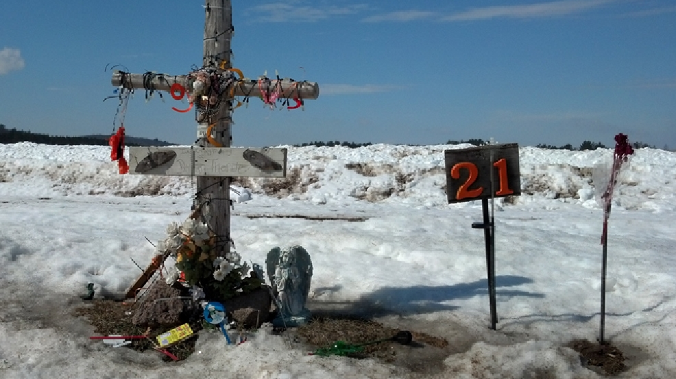 A memorial to Dylan Thorne, who was killed in a 2012 crash, is seen along Hwy. E in the Waupaca County town of St. Lawrence, March 14, 2014. (WLUK/Ben Krumholz)