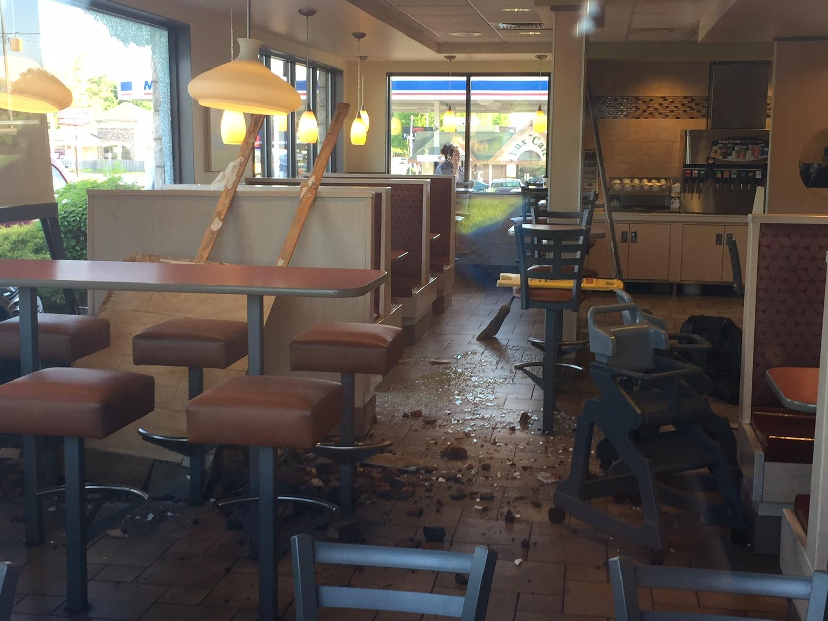 A car crashed into the McDonald's on Capital Avenue in Battle Creek Friday morning. (WWMT/Jason Puhr)<p></p>