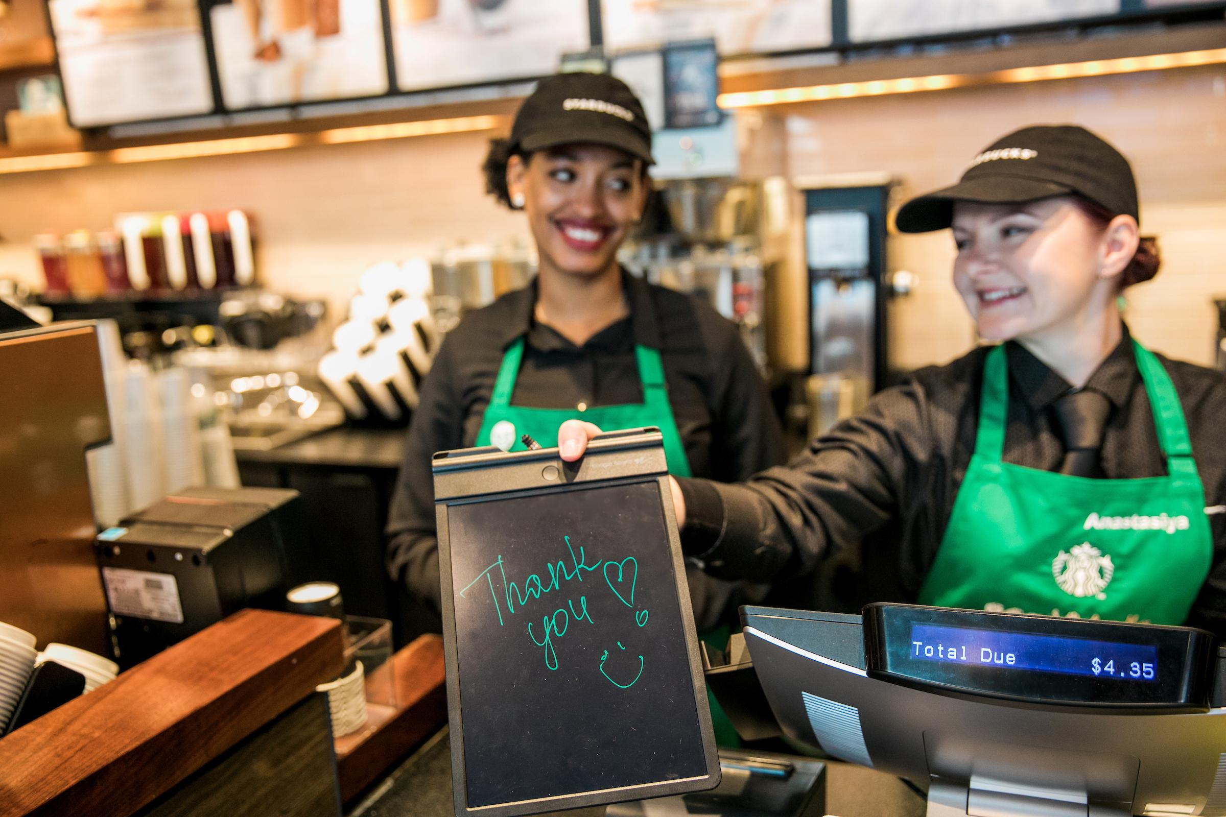 You don't need to know ASL to get your caffeine fix at this Starbucks. You can write your order down and communicate with your barista.{ }(Image: Joshua Trujillo, Starbucks)