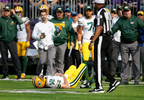 Green Bay Packers quarterback Aaron Rodgers (12) lies on the ground after being hit by Minnesota Vikings outside linebacker Anthony Barr (55) in the first half of a game in Minneapolis, Sunday, Oct. 15, 2017.