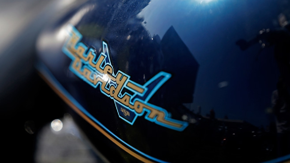 The Harley Davidson museum is reflected in a gas tank during a Harley Davidson 110th anniversary celebration Thursday, Aug. 29, 2013, in Milwaukee. (AP Photo/Morry Gash)