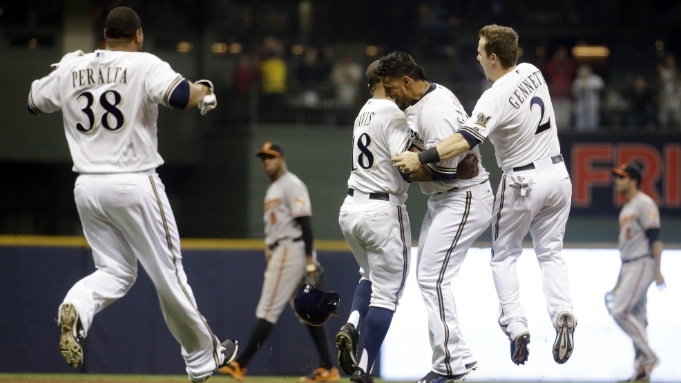Milwaukee Brewers' Yovani Gallardo is mobbed by teammates 25after hitting a game-winning double during the 10th inning of a baseball game against the Baltimore Orioles Tuesday, May 27, 2014, in Milwaukee. The Brewers won 7-6. (AP Photo/Morry Gash)