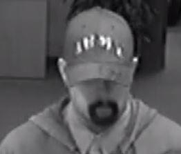 The FBI says the man was wearing a fake mustache and goatee.