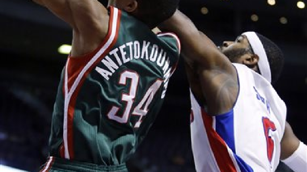 Milwaukee Bucks guard Giannis Antetokounmpo (34) gets past Detroit Pistons forward Josh Smith, right, for a dunk during the first half of an NBA basketball game Monday, March 31, 2014, in Auburn Hills, Mich. (AP Photo/Duane Burleson)