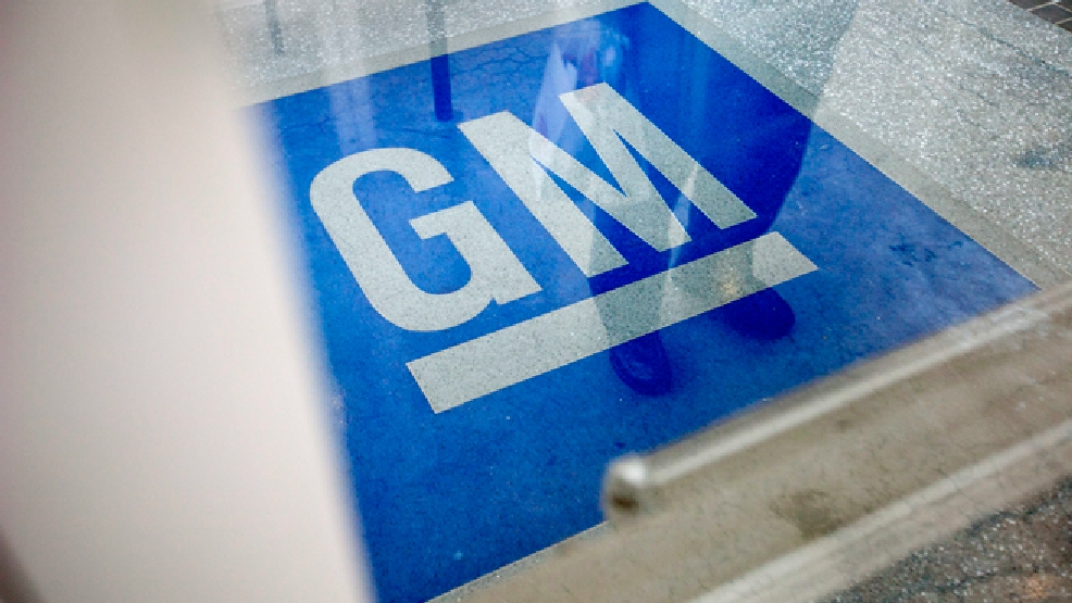 FILE - In this Thursday, Jan. 10, 2013 file photo, the logo for General Motors decorates the entrance at the site of a GM information technology center in Roswell, Ga. (AP Photo/David Goldman, File)
