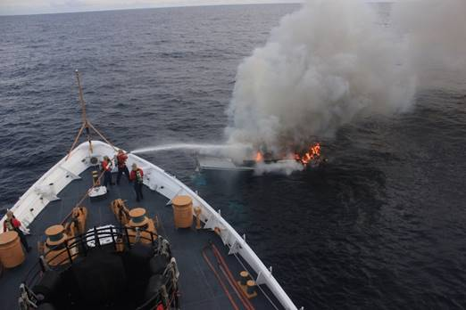"Coast Guard members aboard the USCG Steadfast battling the fire on the ""Tarry-A-Bit""  (Photo: U.S. Coast Guard)"