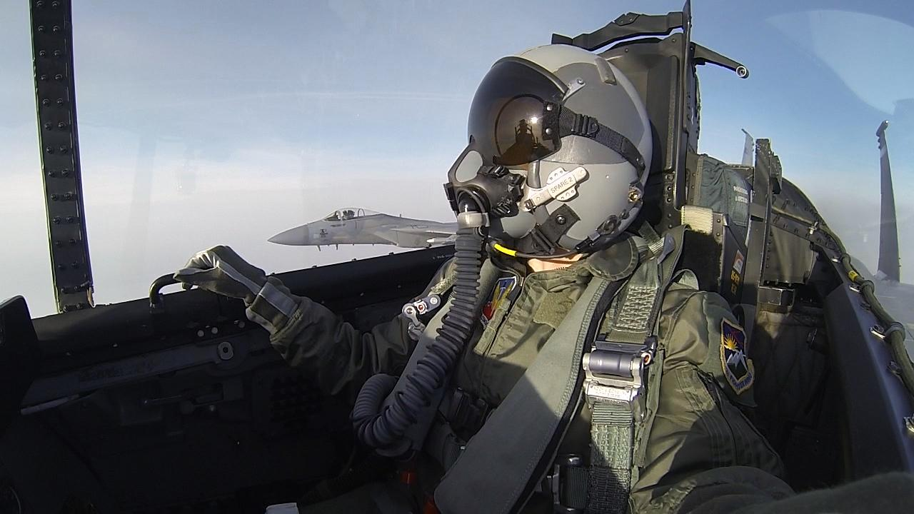 KATU's Jackie Labrecque looks out the window of an F-15 at wingman Lt. Col. Bill Kopp in another F-15 while flying with the Oregon Air National Guard's 142nd Fighter Wing. (KATU Photo)<p></p>