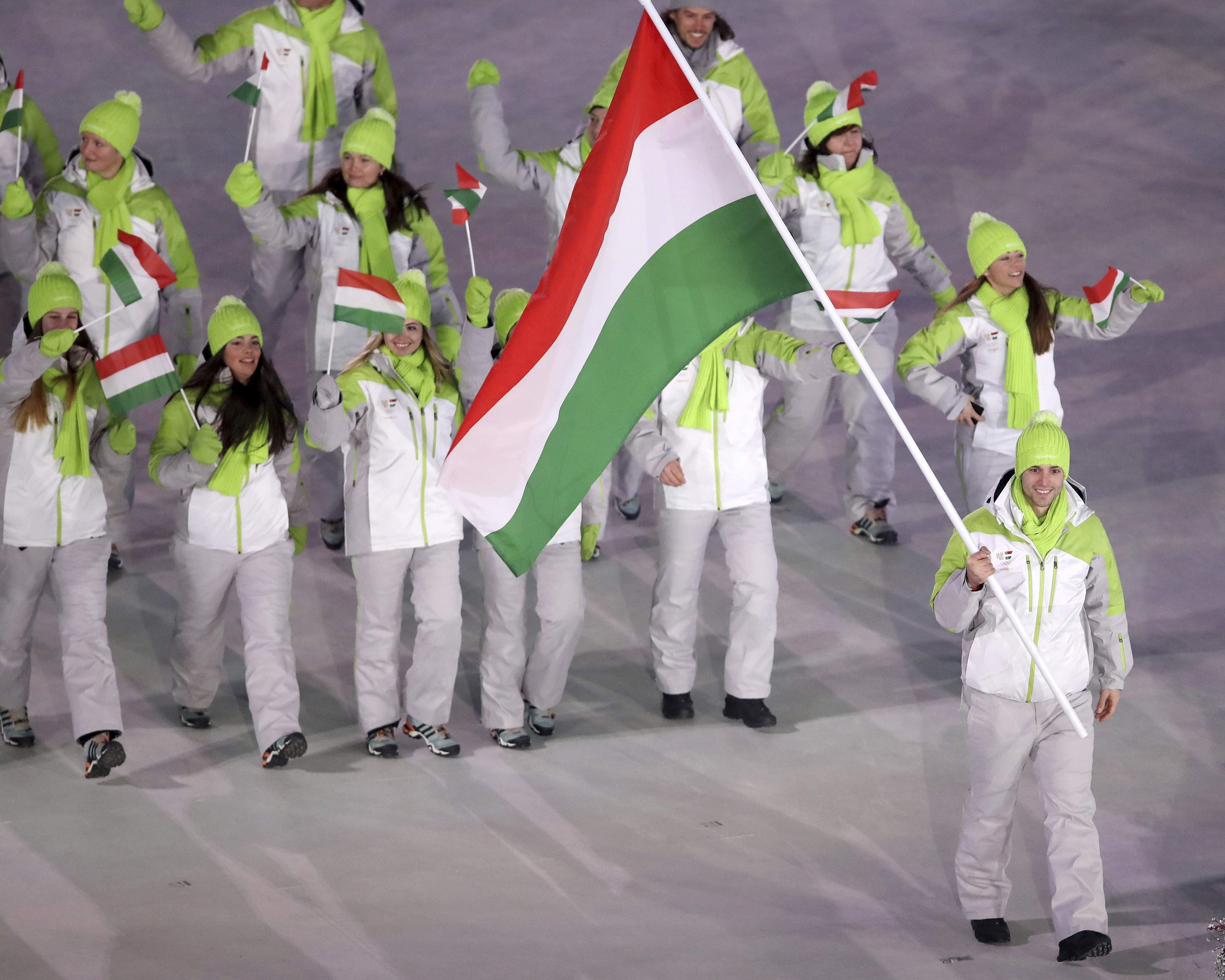 Konrad Nagy carries the flag of Hungary during the opening ceremony of the 2018 Winter Olympics in Pyeongchang, South Korea, Friday, Feb. 9, 2018. (Sean Haffey/Pool Photo via AP)