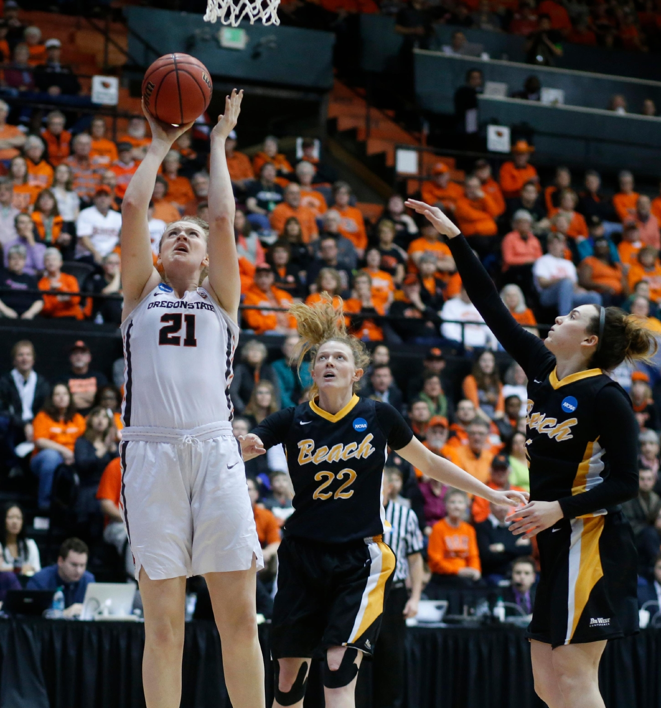 Oregon State's Marie Gulich (21) gets behind Long Beach State's Madison Montgomery (22) and Gigi Hascheff (5) for two points during the first half of a first-round game in the women's NCAA college basketball tournament Friday, March 17, 2017, in Corvallis, Ore. (AP Photo/ Timothy J. Gonzalez)