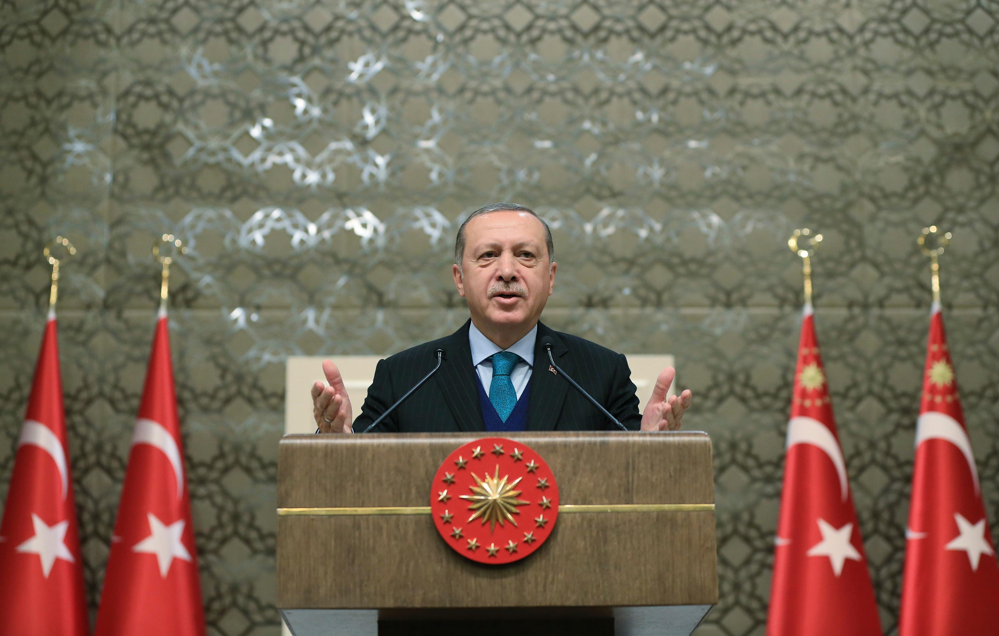 "Turkey's President Recep Tayyip Erdogan, gestures as he delivers a speech at an event in Ankara, Turkey, Tuesday, Dec. 12, 2017. Leaders and high-ranking officials of Muslim countries will meet Wednesday Dec. 13, in Istanbul for an extraordinary summit to discuss the U.S. recognition of Jerusalem as Israel's capital. Erdogan_ term president of the Organization of Islamic Cooperation, the umbrella organization of 57-members_has been vehemently critical of the U.S. move and said the leaders would relay a ""strong message."" (Pool Photo via AP)"