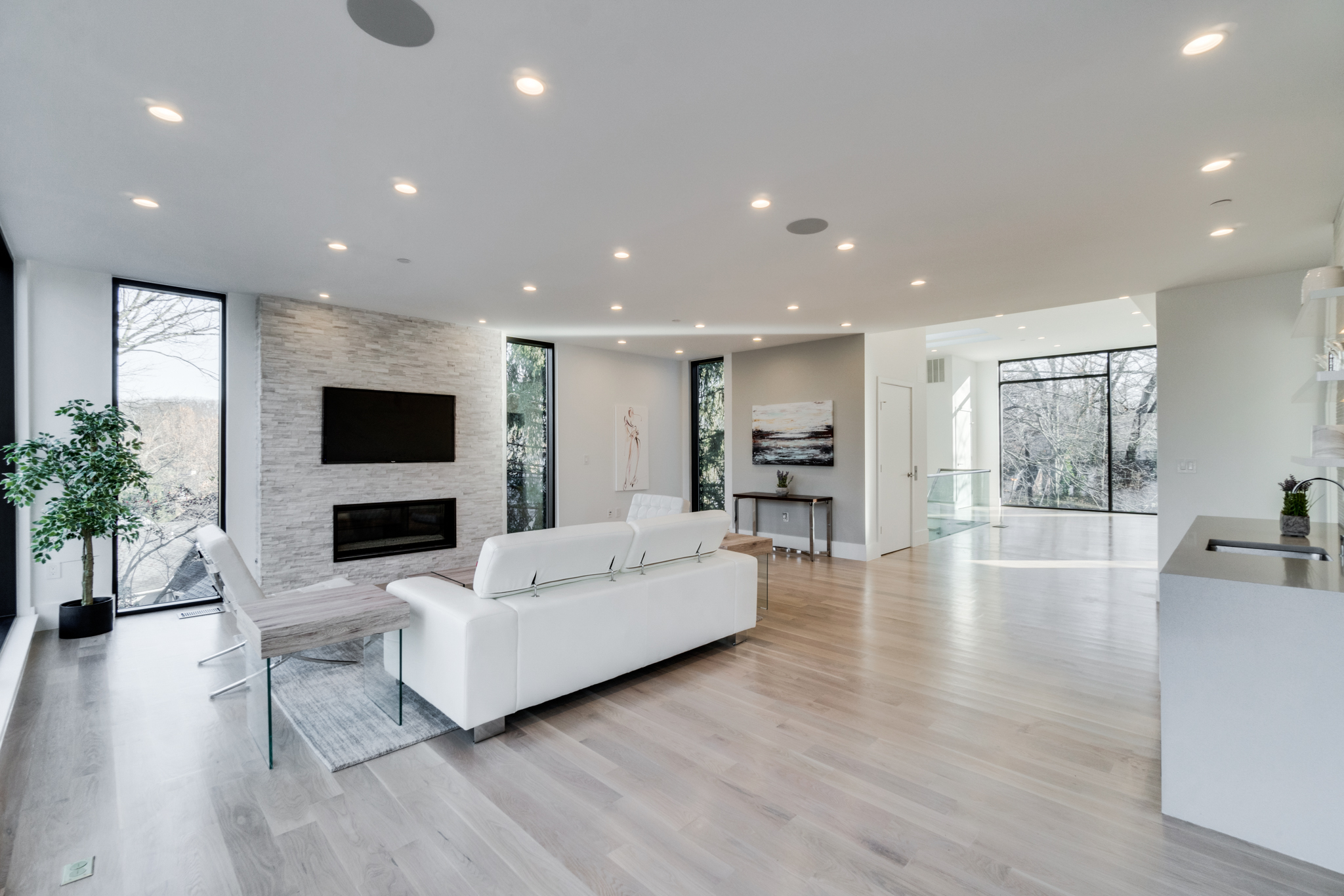 "This modern four-story home in Forest Hills just hit the market and we admit... we have house envy! Built in 2018, the 7,300-square-foot property has six bedrooms, five full bathrooms, one half bath, two fireplaces, a finished basement (with a rec room, sauna and wine cellar), a heated outdoor pool and a two-car garage. The floor-to-ceiling windows throughout the home give off a ""treehouse-like"" vibe and offer unobstructed views of Rock Creek Park, plus lots of natural light. The current asking price is $3,875,000. For more information, you can see the full listing here (http://bit.ly/2DPbbbD) or contact listing agents Patrick Chauvin/Brad  House of Compass Real Estate. (Image: Courtesy Compass Real Estate)"