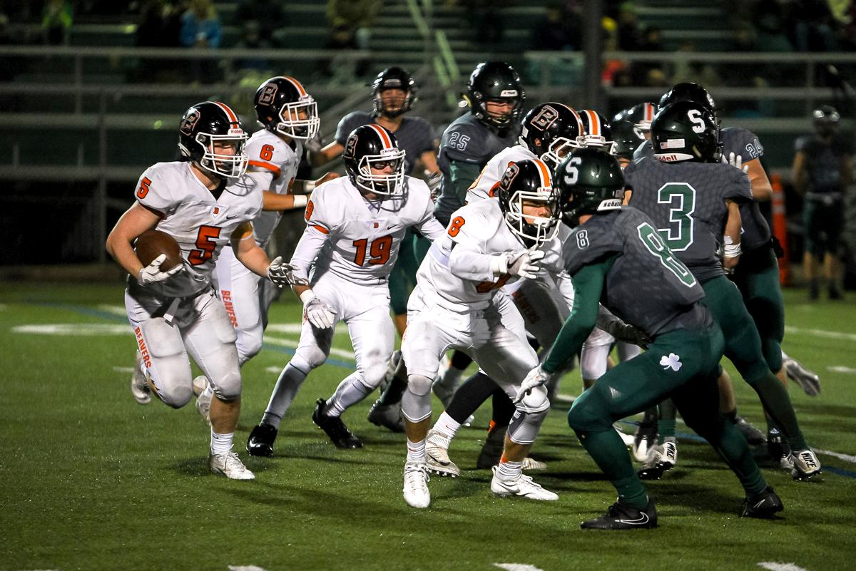Beaverton running back Trevor McDonald (#5) racks up yardage during Beaverton's 48-7 loss to Sheldon in the first round of the state high school playoffs.  Photo by Jeff Dean Oregon News Lab