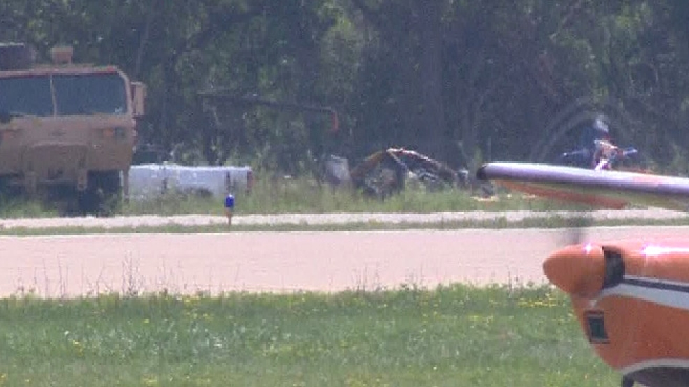 A crashed plane is towed away from Wittman Regional Airport in Oshkosh, July 31, 2014. (WLUK photo)