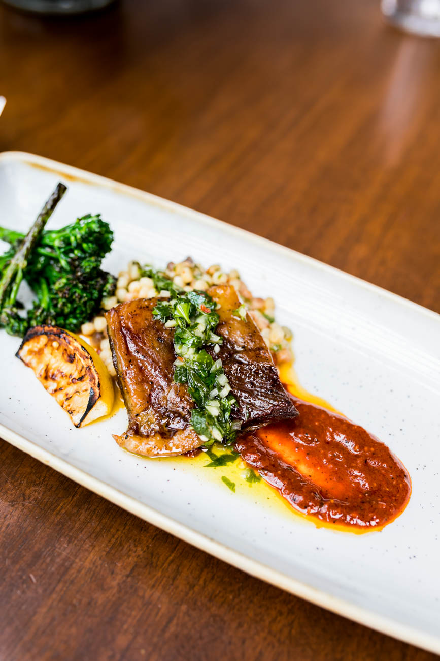 Elysian Fields Farm lamb belly served with charred rapini, fregula, harissa, and grilled lemon / Image: Amy Elisabeth Spasoff // Published: 4.23.18