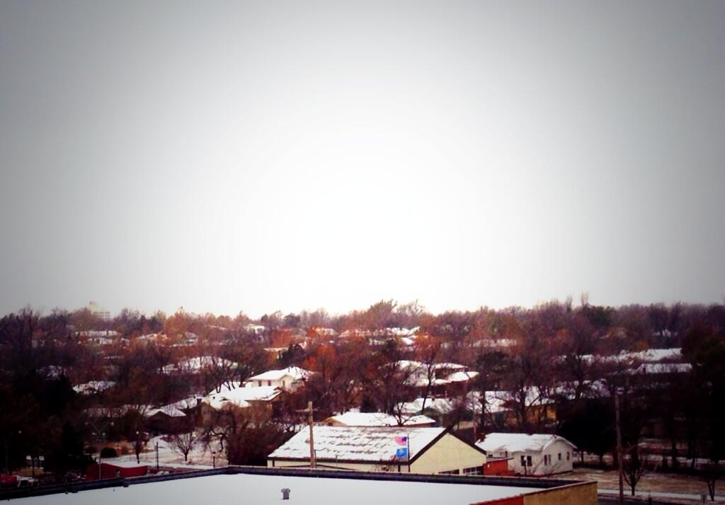 Snow covers rooftops in Oklahoma City