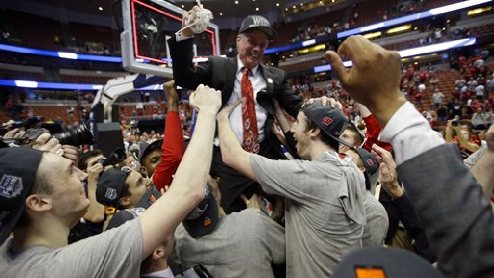 Players lift Wisconsin head coach Bo Ryan after a regional final NCAA college basketball tournament game against Arizona, Saturday, March 29, 2014, in Anaheim, Calif. Wisconsin won 64-63 in overtime. (AP Photo/Jae C. Hong)