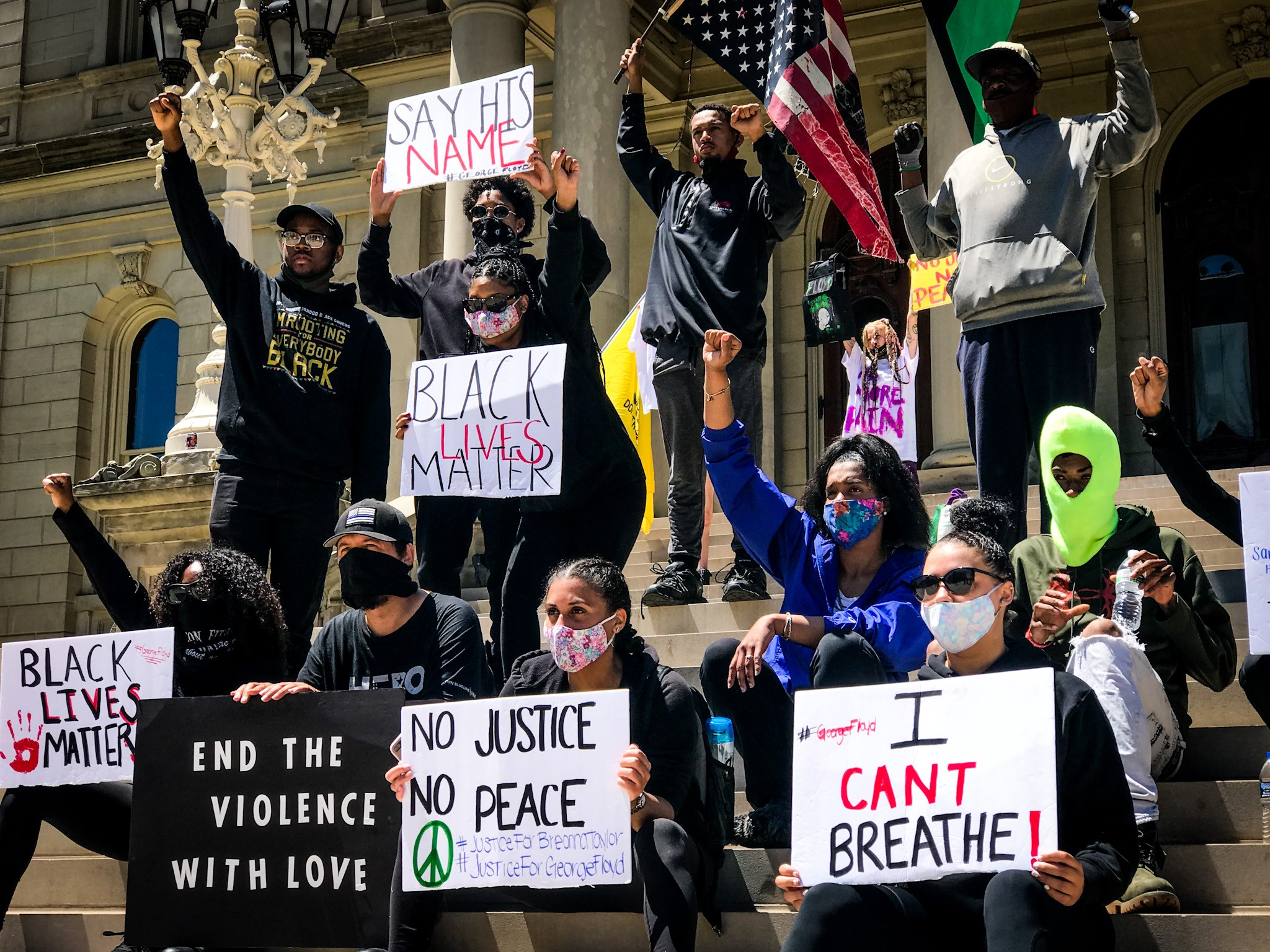 On Sunday, May 31, 2020 people gathered in Lansing to protest the death of George Floyd. This image was captured while the protest was peaceful. (WWMT/Mikenzie Frost)