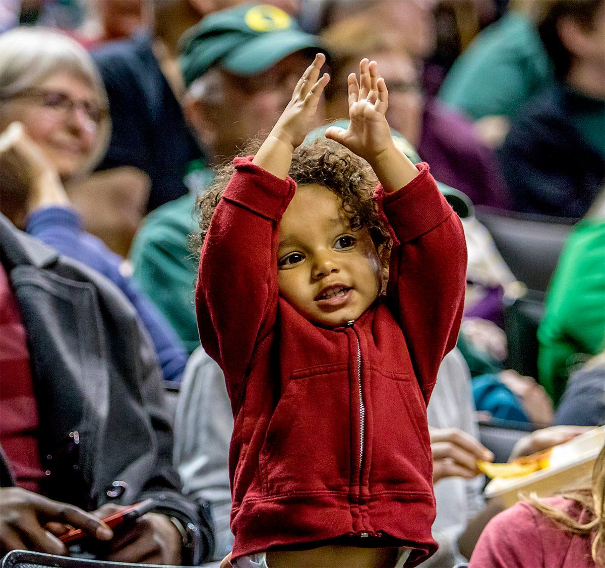 A young Stanford fan cheers on his team. The Stanford Cardinal defeated the Oregon Ducks 78-65 on Sunday afternoon at Matthew Knight Arena. Stanford is now 10-2 in conference play and with this loss the Ducks drop to 10-2. Leading the Stanford Cardinal was Brittany McPhee with 33 points, Alanna Smith with 14 points, and Kiana Williams with 14 points. For the Ducks Sabrina Ionescu led with 22 points, Ruthy Hebard added 16 points, and Satou Sabally put in 14 points. Photo by August Frank, Oregon News Lab