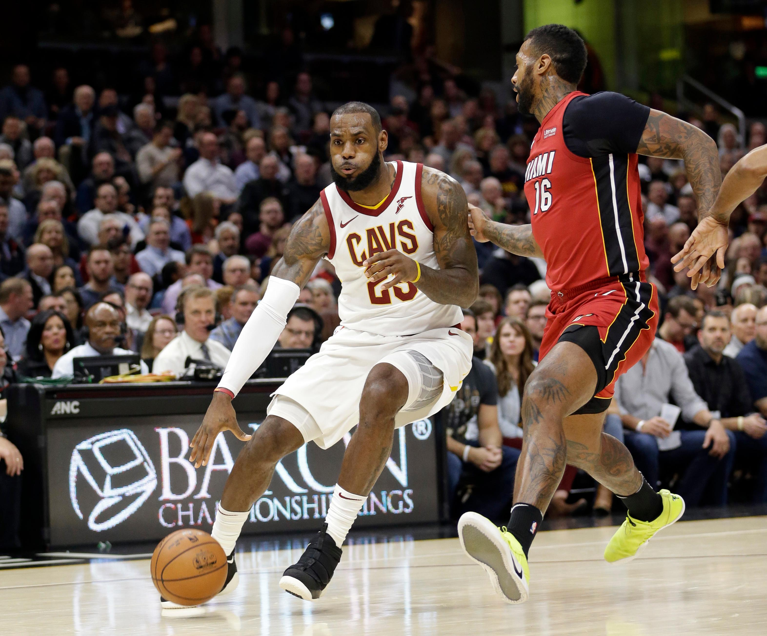 Cleveland Cavaliers' LeBron James (23) drives against Miami Heat's James Johnson (16) in the first half of an NBA basketball game, Tuesday, Nov. 28, 2017, in Cleveland. (AP Photo/Tony Dejak)