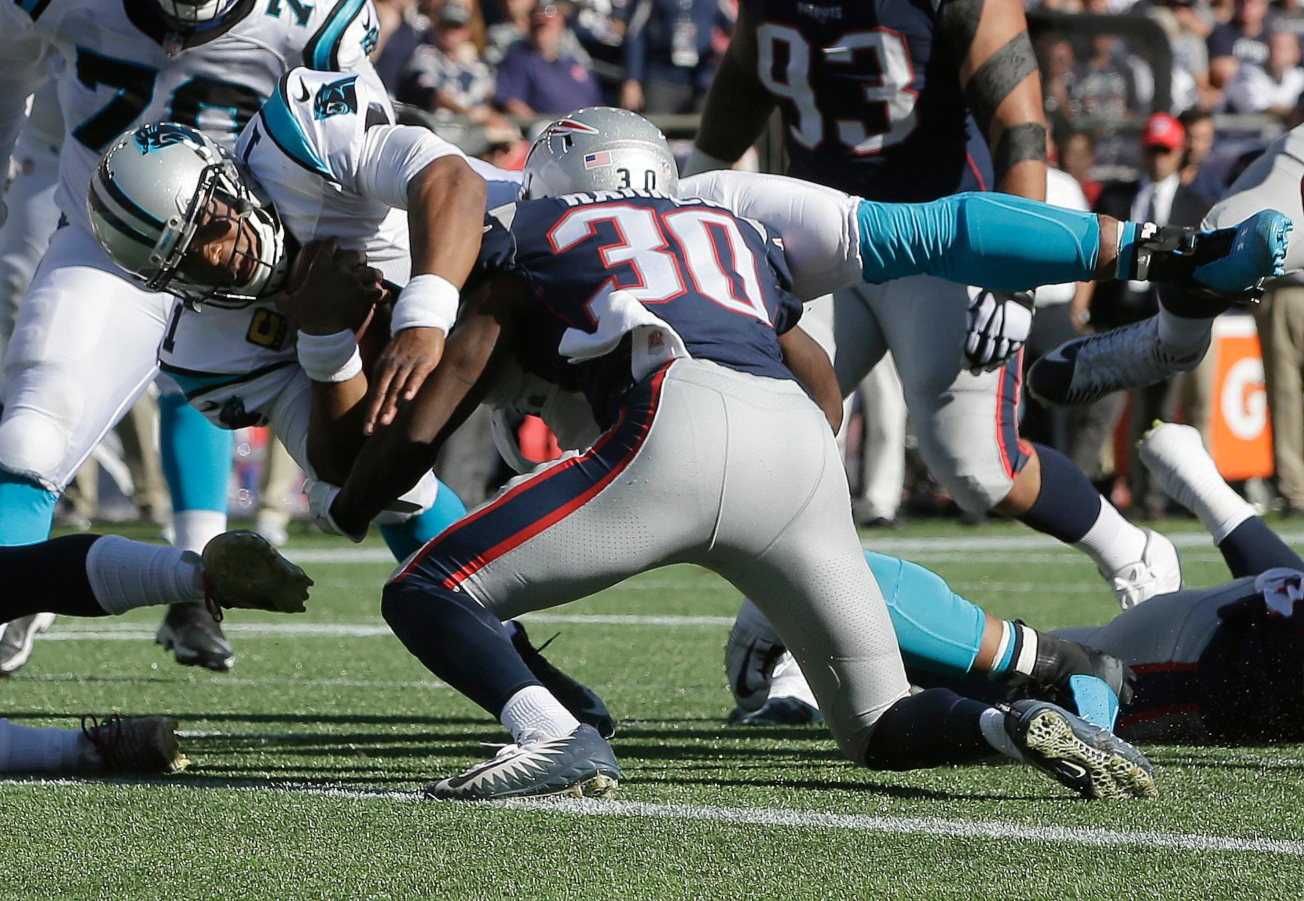 Carolina Panthers quarterback Cam Newton dives for a touchdown past New England Patriots safety Duron Harmon (30) during the second half of an NFL football game, Sunday, Oct. 1, 2017, in Foxborough, Mass. (AP Photo/Steven Senne)