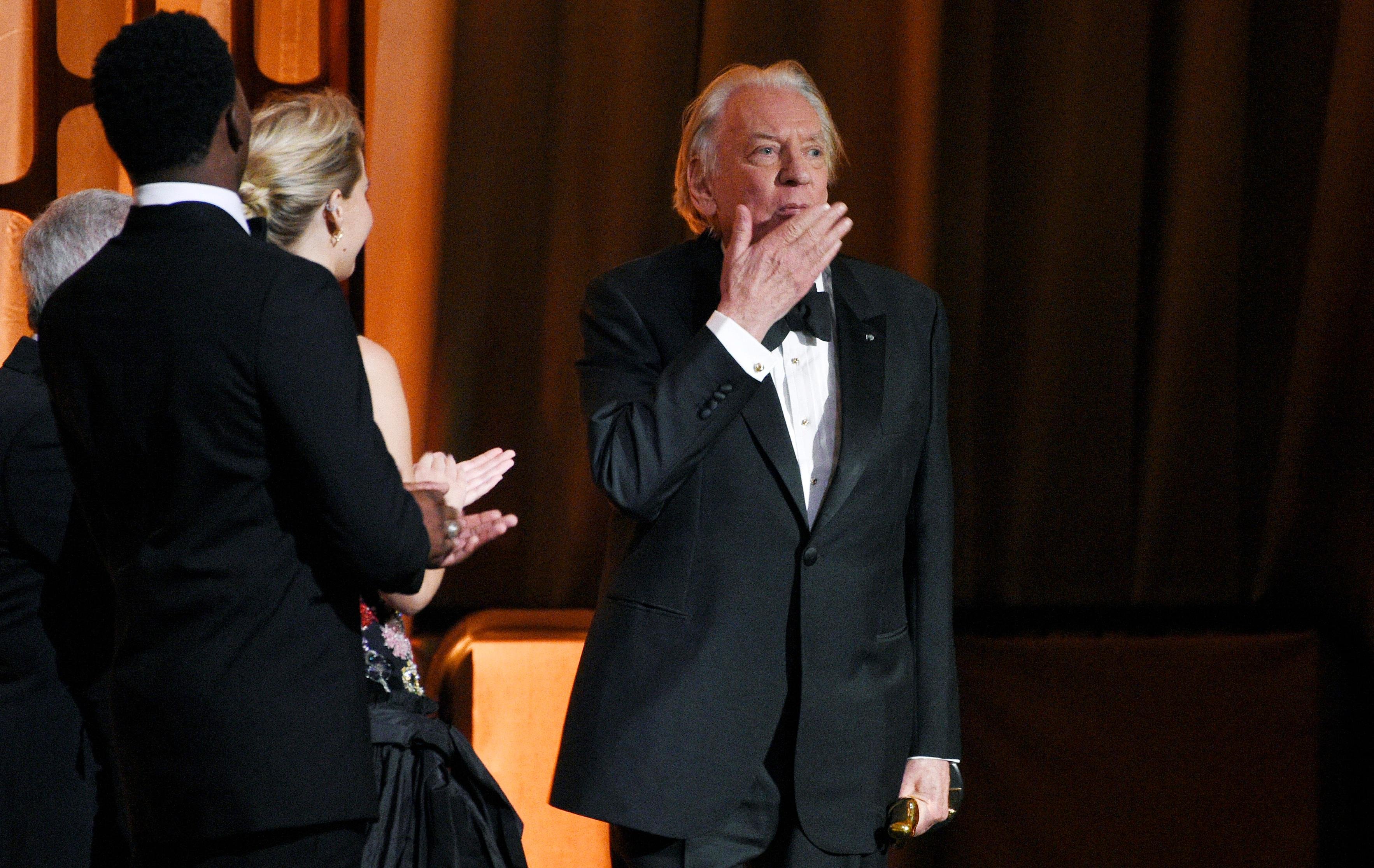 Actor Donald Sutherland blows a kiss to the audience after receiving an honorary Oscar at the 2017 Governors Awards at The Ray Dolby Ballroom on Saturday, Nov. 11, 2017, in Los Angeles. (Photo by Chris Pizzello/Invision/AP)