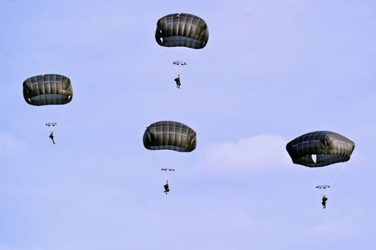 U.S. soldiers descend to the drop zone with their T-11 parachutes full open during a combat training jump from a C-130 Hercules aircraft at the 7th Army Joint Multinational Training Command's Grafenwoehr Training Area, Germany, Oct. 22, 2013.
