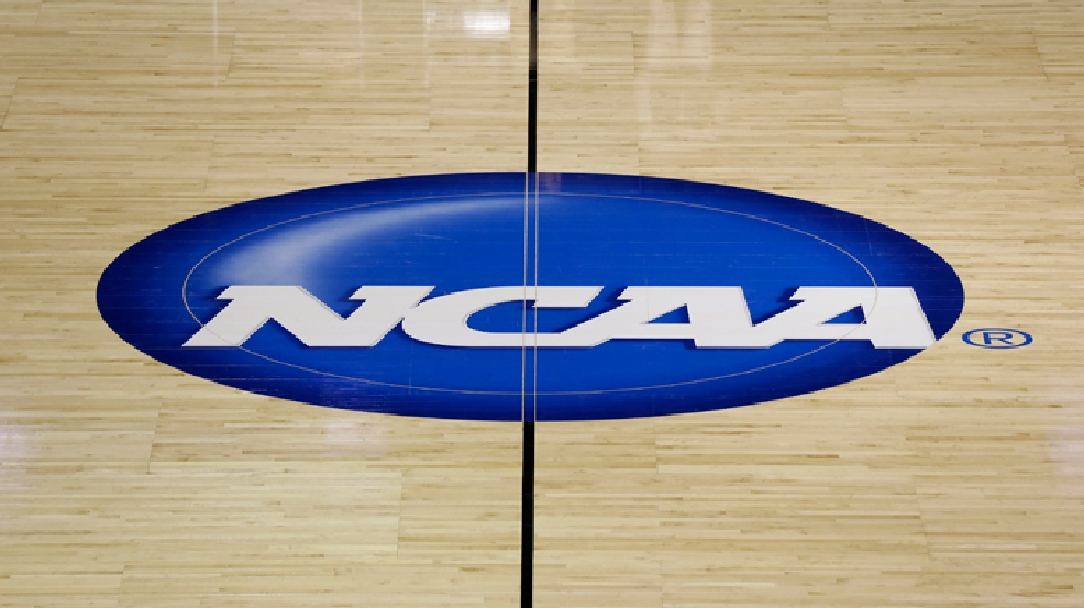 The NCAA logo is shown at half court during practice for second-round games of the NCAA college basketball tournament at The Palace in Auburn Hills, Mich., Wednesday, March 20, 2013. (AP Photo/Paul Sancya)