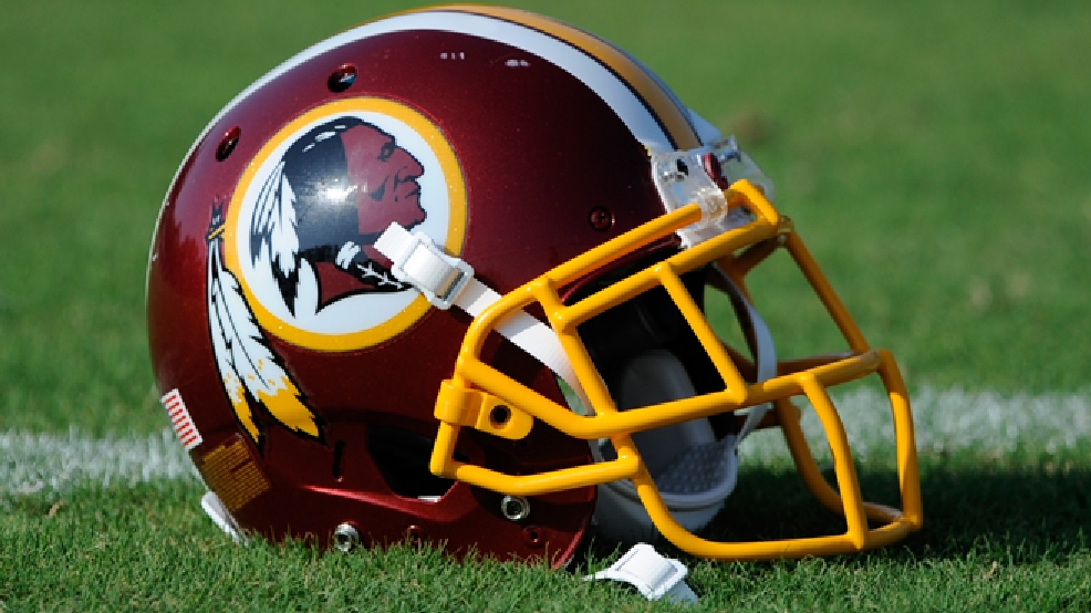 A Washington Redskins football helmet lies on the field during NFL football minicamp, Wednesday, June 18, 2014, in Ashburn, Va. (AP Photo/Nick Wass)