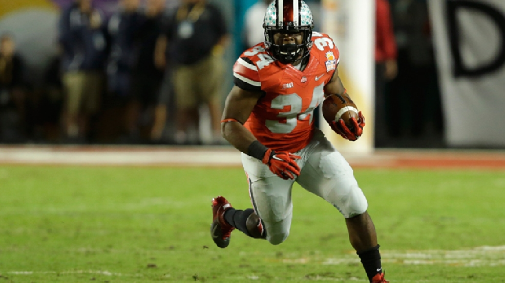 Ohio State running back Carlos Hyde (34) runs during the first half of the Orange Bowl NCAA college football game against Clemson, Friday, Jan. 3, 2014, in Miami Gardens, Fla. (AP Photo/Wilfredo Lee)