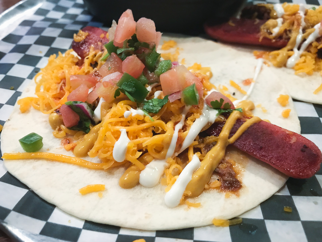 PLACE: Jefferson Social / WHAT: A bar and restaurant that serves chicken and pork tacos on top of a menu of unconventional offerings, such as a Cincinnati chili-themed taco. / WHERE ON WALNUT: The Banks (101 E. Freedom Way) / Image: Cincinnati Refined // Published: 12.6.17<p></p>