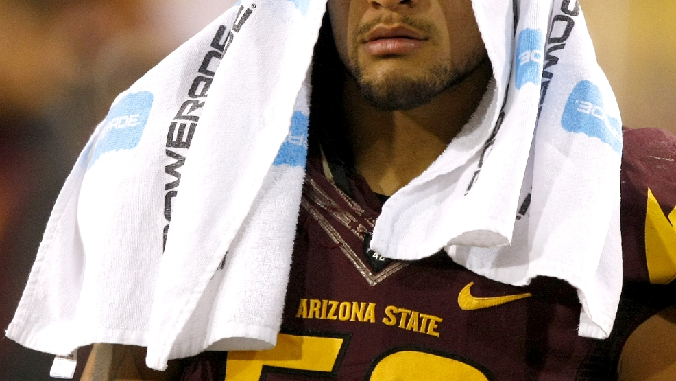 Arizona State linebacker Carl Bradford (52) sits on the side lines after getting into an altercation with head coach Todd Graham during the second half of an NCAA college football game against Oregon State on Saturday, Nov. 16, 2013, in Tempe, Ariz. The Sun Devils defeated the Beavers 30-17. (AP Photo/Rick Scuteri)