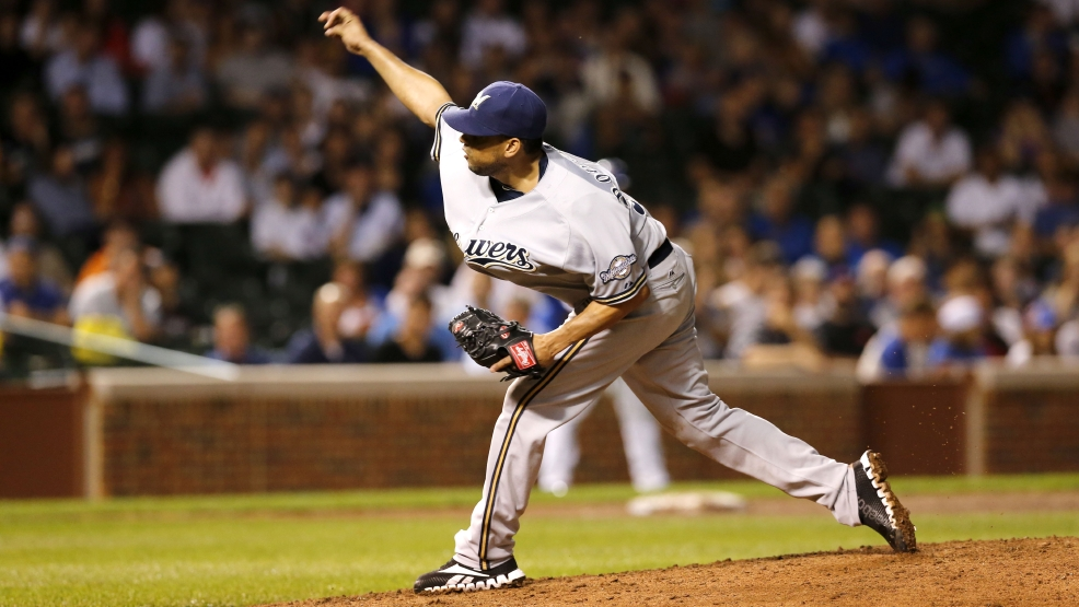 Milwaukee Brewers relief pitcher Francisco Rodriguez delivers during the ninth inning of a baseball game and the Brewers' 3-1 win over the Chicago Cubs Monday, Aug. 11, 2014, in Chicago. (AP Photo/Charles Rex Arbogast)