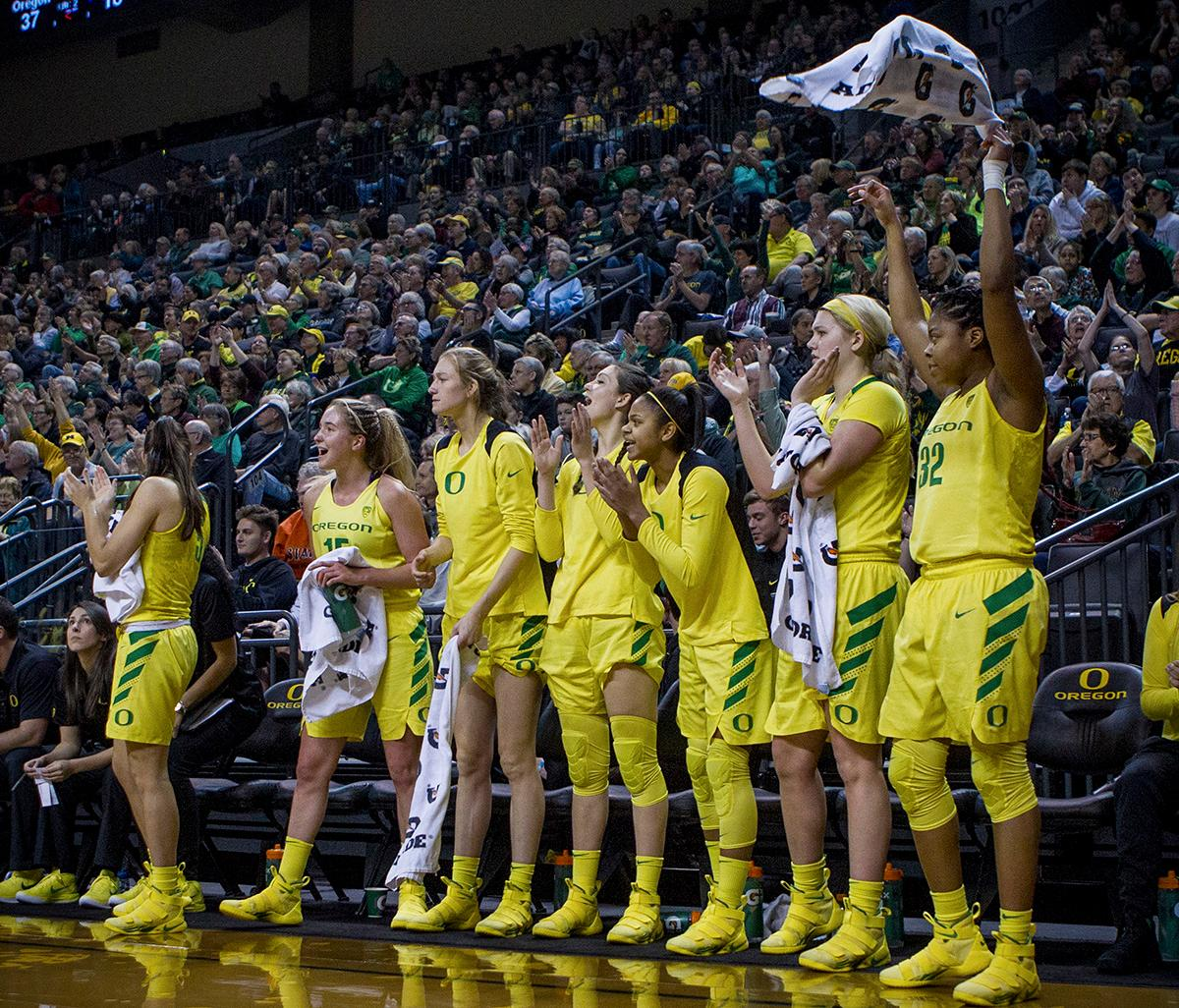 Oregon Ducks team mates cheer from the bench during the second half of their game against the Washington Huskies on Sunday evening. The Oregon Ducks defeated the Washington Huskies 94-83 on Sunday at Matthew Knight Arena. The victory was Head Coach Kelly Graves' 500th career win. Sabrina Ionescu also set the new NCAA all time record of 8 triple doubles in just 48 games. The previous record was 7 triple doubles in 124 games, held by Susie McConnell at Penn State. The Ducks will next face off against USC on Friday January 5th in Los Angeles. Photo by Rhianna Gelhart, Oregon News Lab