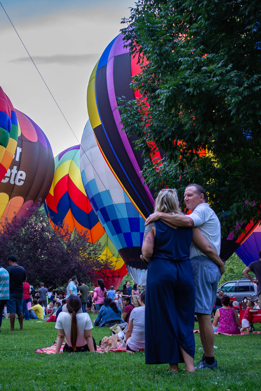 Over a dozen hot air balloons illuminated the sky as the sun set. They were organized by balloon meister Brian Trapp, who has coordinated the display every year. Visitors were able to walk around and see them up-close. / Image: Katie Robinson, Cincinnati Refined