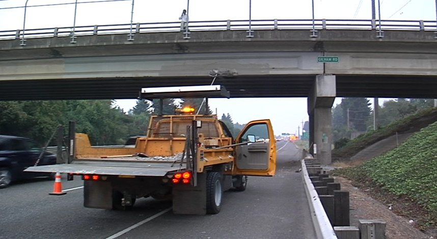 A backhoe being towed on a trailer hit an overpass Wednesday evening. (SBG)
