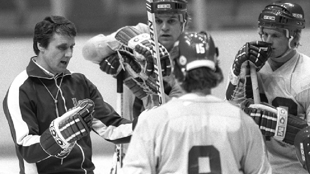 United States Olympic ice hockey coach, Herb Brooks, left, speaks to members of the team during a break in practice at the Ice Hall in Lake Placid, N.Y. in this Feb, 8, 1980 photo. (AP Photo/Douglas Ball)