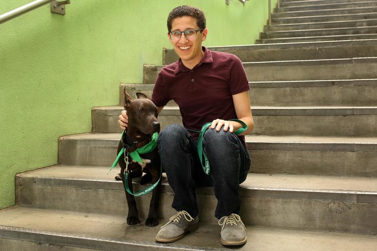 Zach is a 28-year-old economist from Los Angeles. He is currently living in DC and enjoys traveling, baking, and reading. // Tucker is a 4-month-old lab mix who up for adoption at Lucky Dog Animal Rescue. (Amanda Andrade-Rhoades/DC Refined)