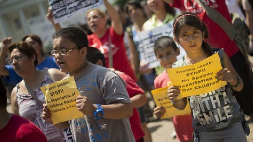 Alexandria Diaz, 9, from Baltimore, Md., joins her parents during a march in front of the White House in Washington, Monday, July 7, 2014, following a news conference of immigrant families and children's advocates responding to the President Barack Obama's response to the crisis of unaccompanied children and families illegally entering the US.  (AP Photo/Pablo Martinez Monsivais)