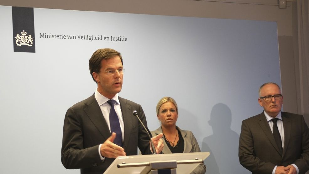 Dutch Prime Minister Mark Rutte, left, speaks during a press conference accompanied by Defense Minister Jeanine Hennis-Plasschaert, center, and Foreign Minister Frans Timmermans, right, in The Hague, Netherlands, Sunday, July 27, 2014. Rutte explained to the media that his government has decided against sending armed troops to protect the crash site of Malaysia Airlines Flight 17, The Hague, Netherlands. (AP Photo/Mike Corder)