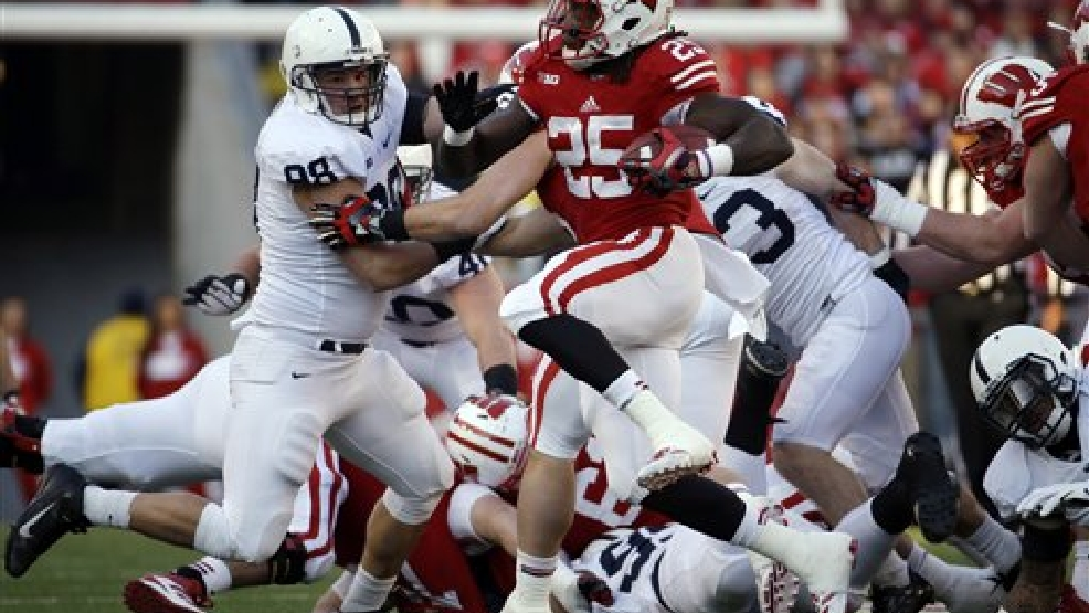 Wisconsin's Melvin Gordon runs during the first half of an NCAA college football game against Penn State Saturday, Nov. 30, 2013, in Madison, Wis. (AP Photo/Morry Gash)