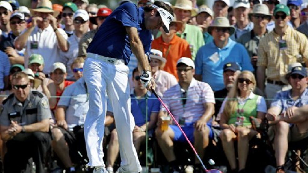 Bubba Watson tees off on the eighth hole during the third round of the Masters golf tournament Saturday, April 12, 2014, in Augusta, Ga. (AP Photo/David J. Phillip)