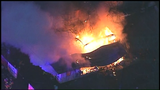 Man trapped inside massive house fire dies