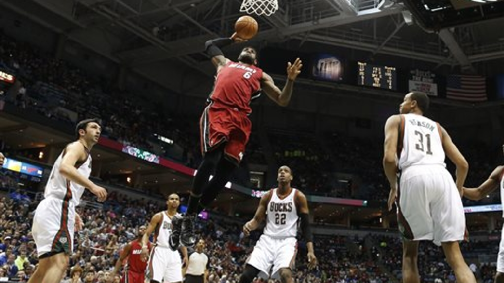 Miami Heat's LeBron James (6) dunks against the Milwaukee Bucks in the first half of an NBA