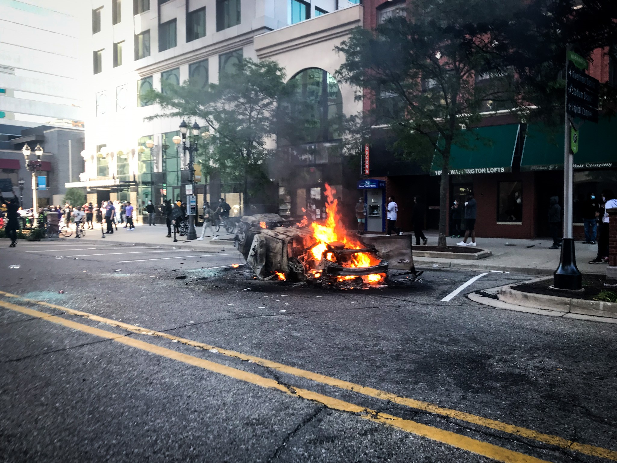A car was completely burned on a street in Lansing after a peaceful protest turned violent on Sunday, May 31, 2020. (WWMT/Mikenzie Frost)