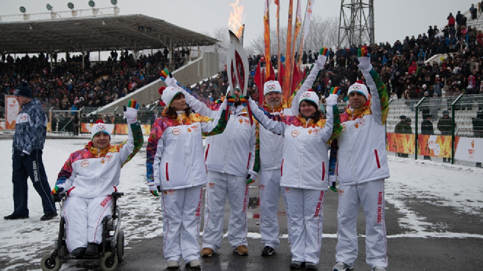 In this photo provided by Olympictorch2014.com, torch bearers pose during a welcome ceremony of the Olympic torch relay in the Caucasus city of Vladikavkaz, the regional capital of North-Ossetia, southern Russia, Thursday, Jan. 30, 2014. The 65,000-kilometer (40,389 mile) Sochi torch relay, which started on Oct. 7, is the longest in Olympic history. The torch has traveled to the North Pole on a Russian nuclear-powered icebreaker and has even been flown into space. (AP Photo/ Olympictorch2014.com)