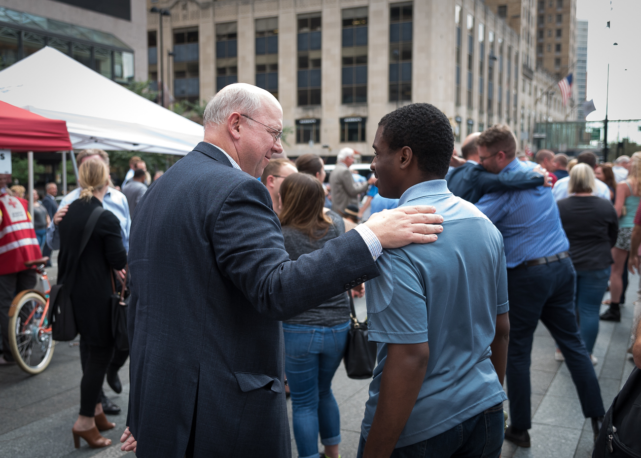 Thousands of Cincinnatians assembled on Fountain Square on the afternoon of Friday, September 7 for a vigil that honored the victims of the violence that occurred at Fifth Third Tower a day earlier. Fifth Third CEO Greg Carmichael, United Way President Michael Johnson, Mayor John Cranley, and religious leaders Ennis Tait and Brian Tome spoke to the masses for a total of around 30 minutes. The event featured moments of silence followed by neighborly affection intended to begin the healing process of the community. After the speeches, attendees lingered on the Square to mingle with the people of Cincinnati. / Image: Phil Armstrong, Cincinnati Refined // Published: 9.8.18