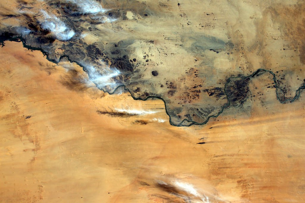 This river in Sudan seems to separate rock and sand like a border (Photo & Caption: Thomas Pesquet // NASA)