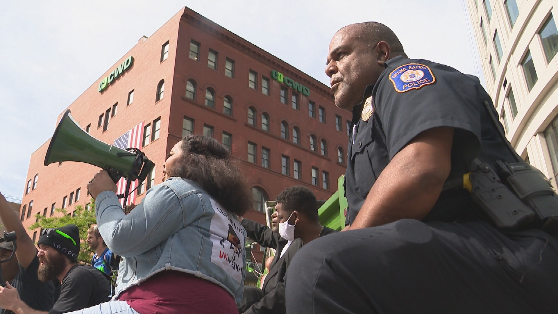 "For nine minutes silent protesters kneeled and chanted ""I can't breathe"" while Kent County Sheriff Michelle LaJoye-Young, Payne and other officers and deputies kneeled and chanted with them.{ }(WWMT/Jason Heeres)"